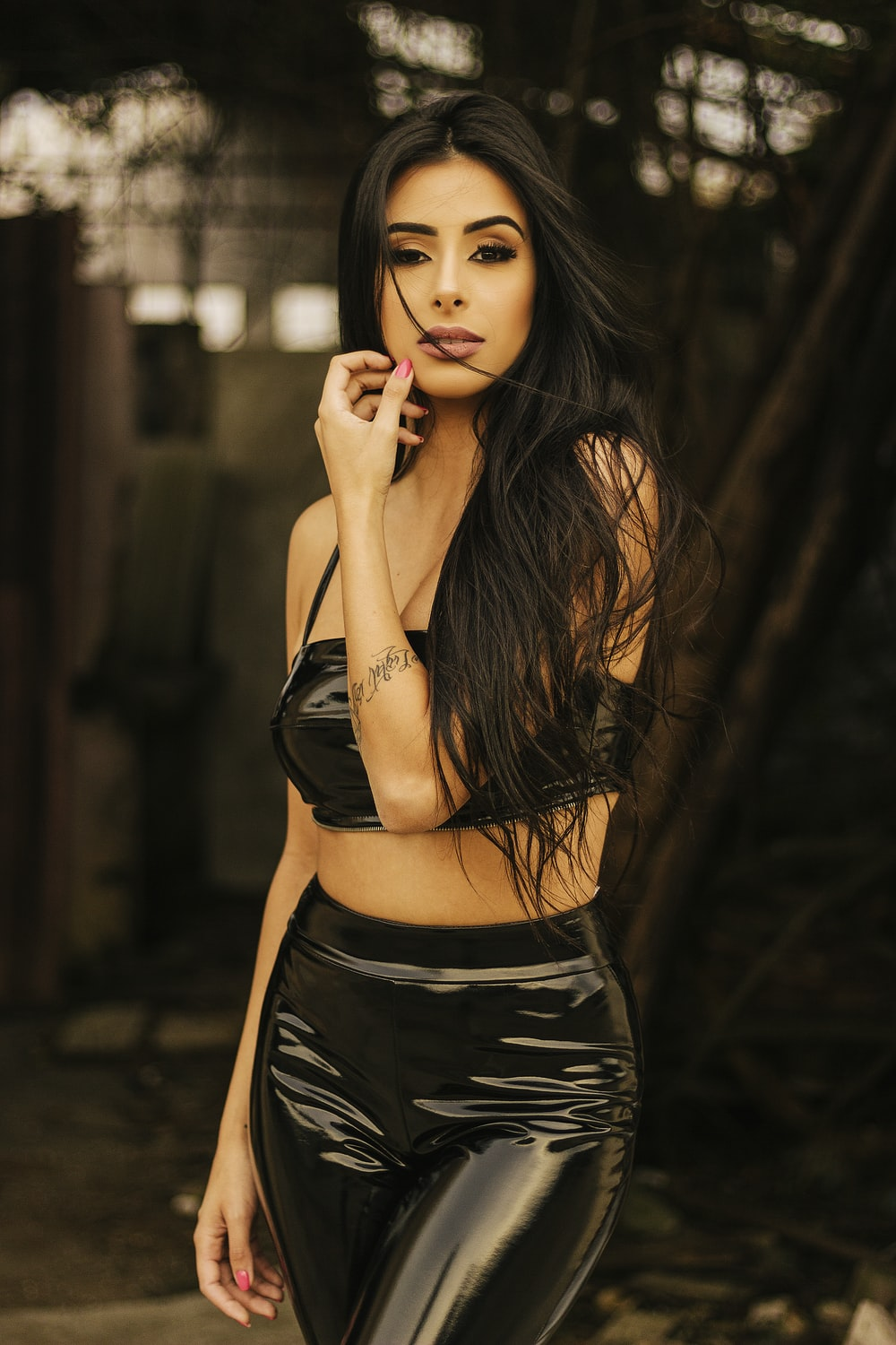 woman in black silk top and pants