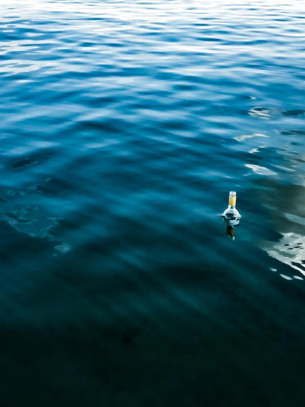 bottle on body of water