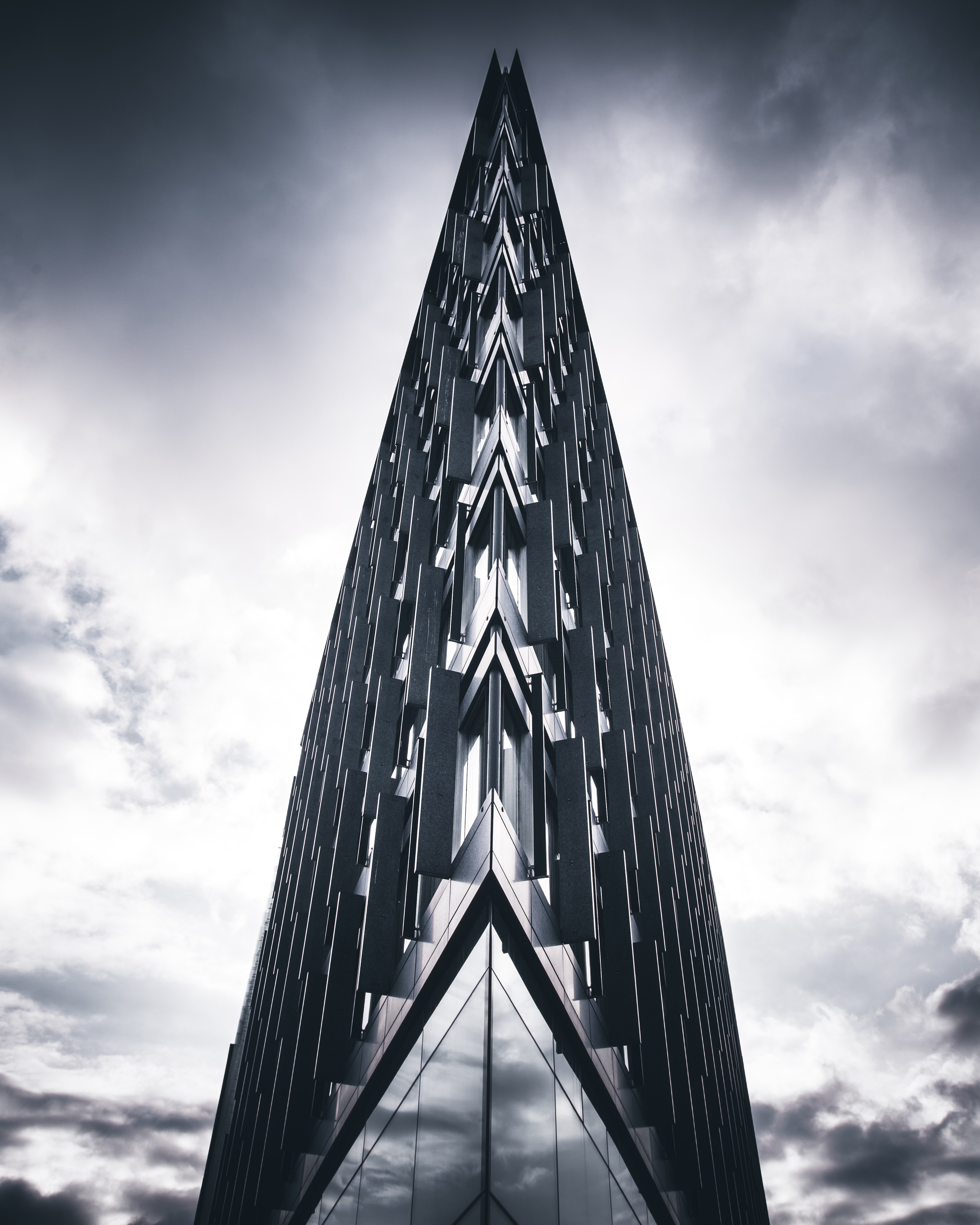 gray glass building under cloudy sky during daytime