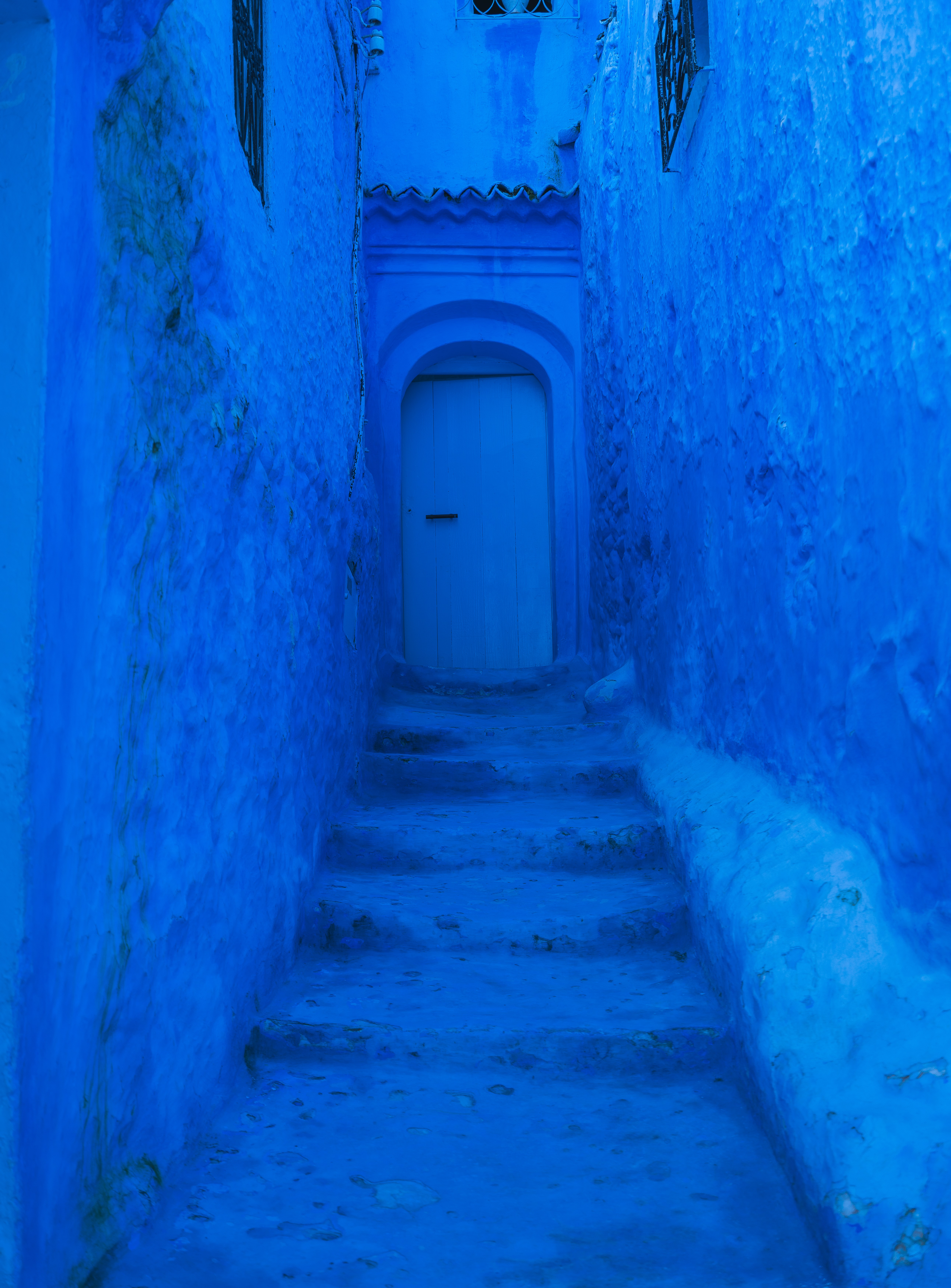 closed door and blue painted wall