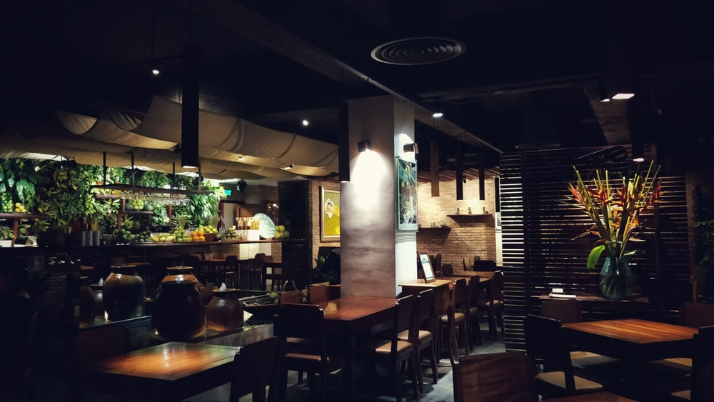 brown wooden chairs and tables on restaurant