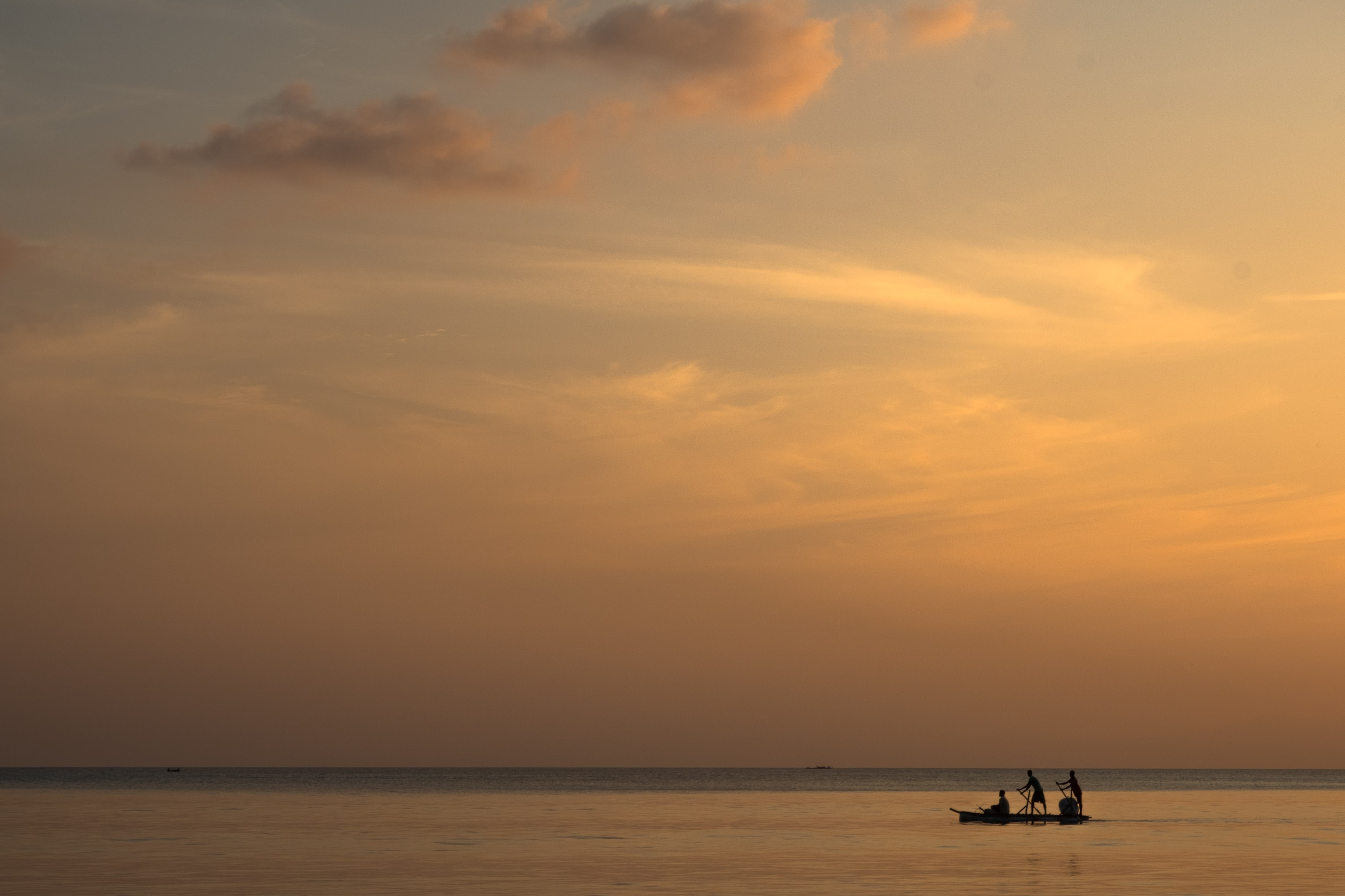 silhouette of people on boat