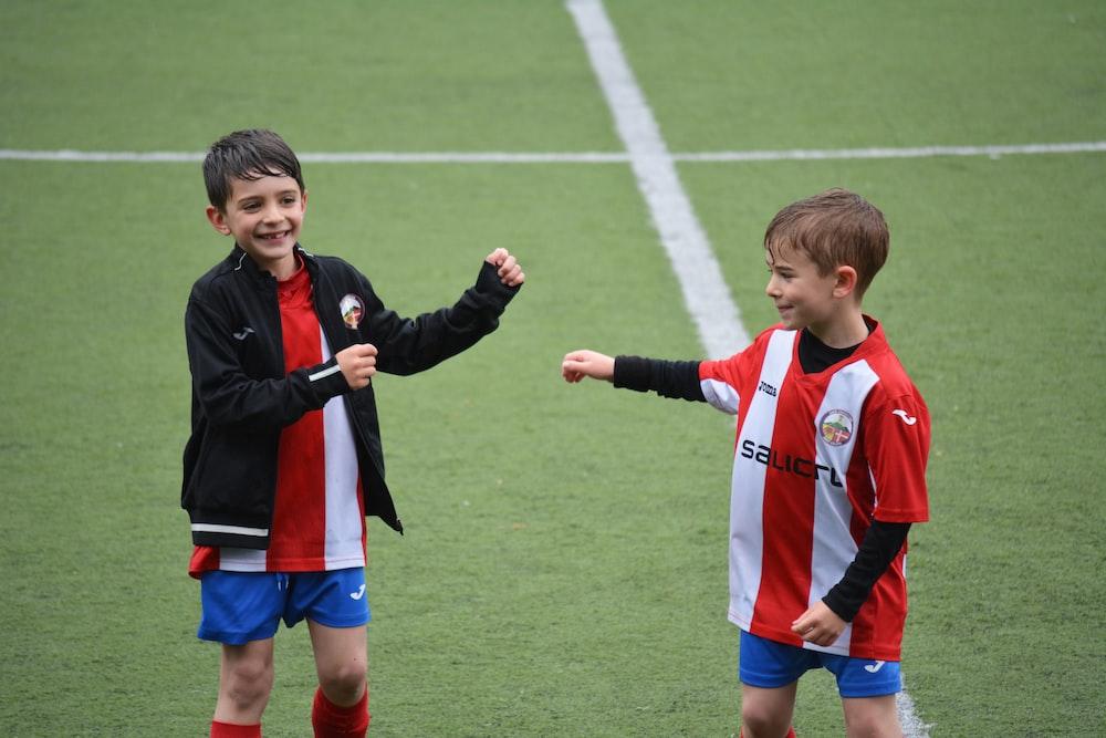 two boys in soccer field