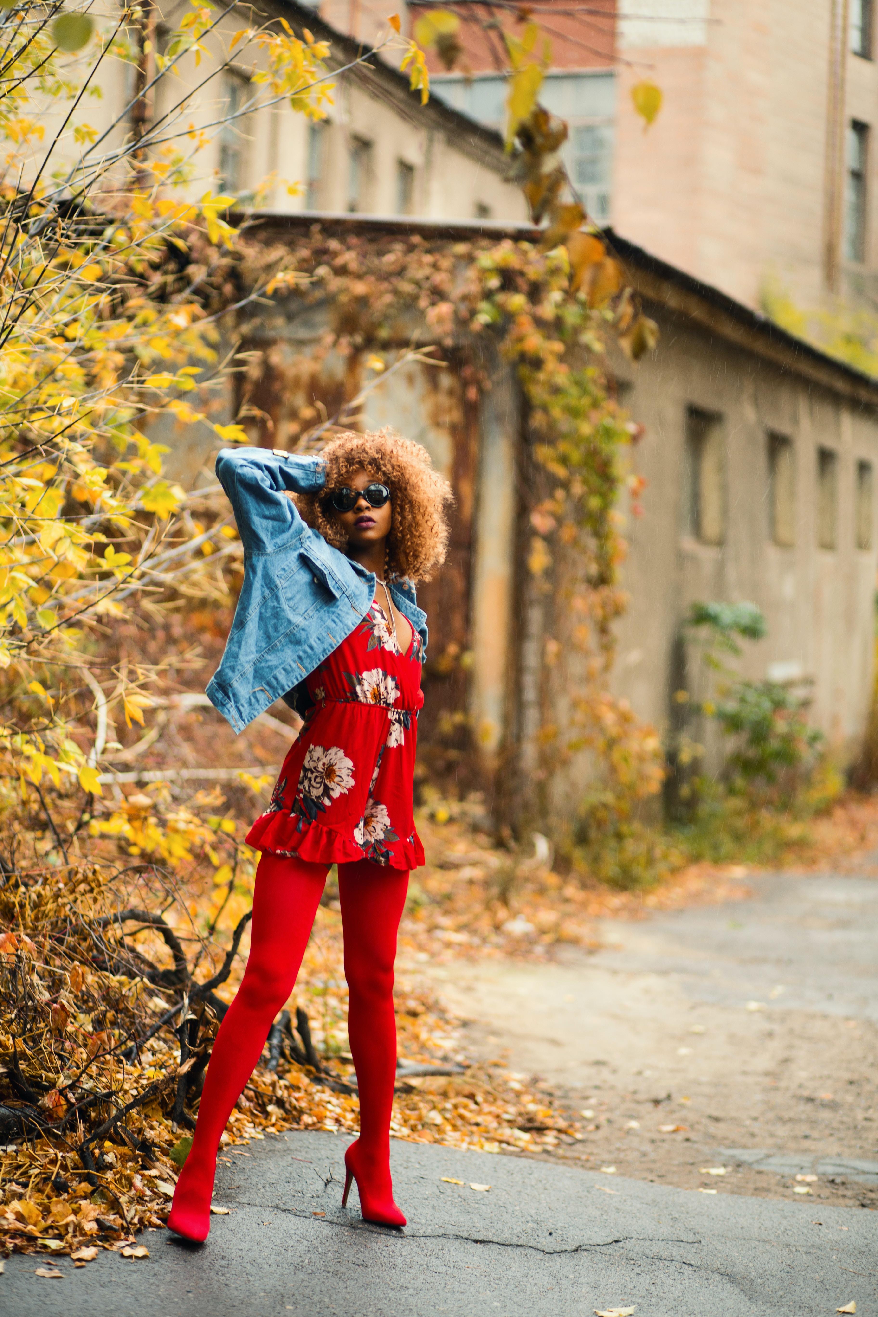 woman standing near yellow leaf tree