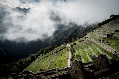step vegetation landscape under white clouds at daytime machu picchu teams background