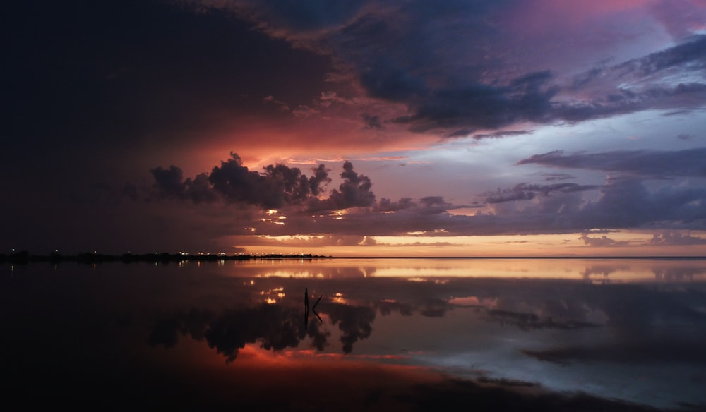 reflective photography of clouds