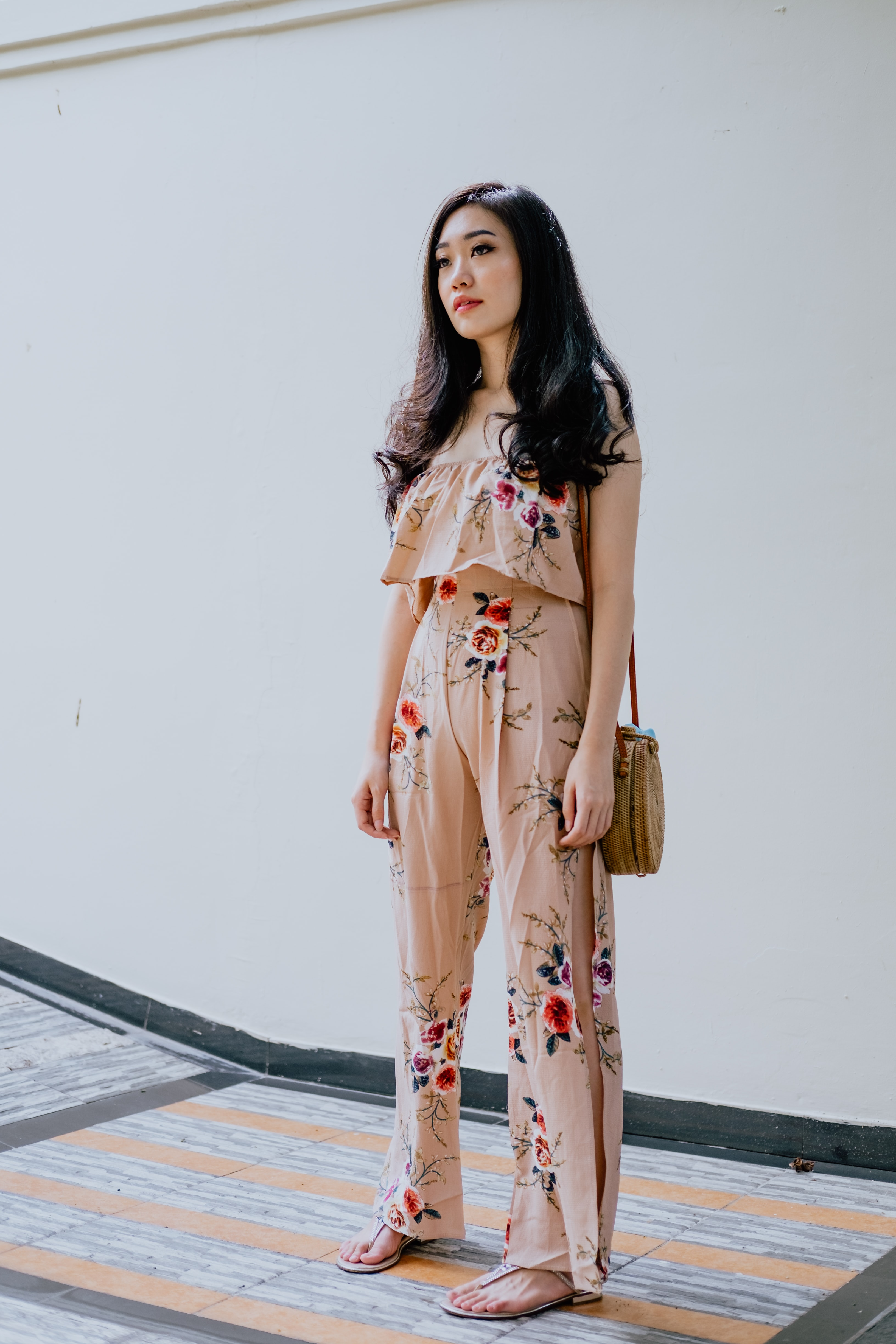 woman wearing beige-and-red floral crop top with pants