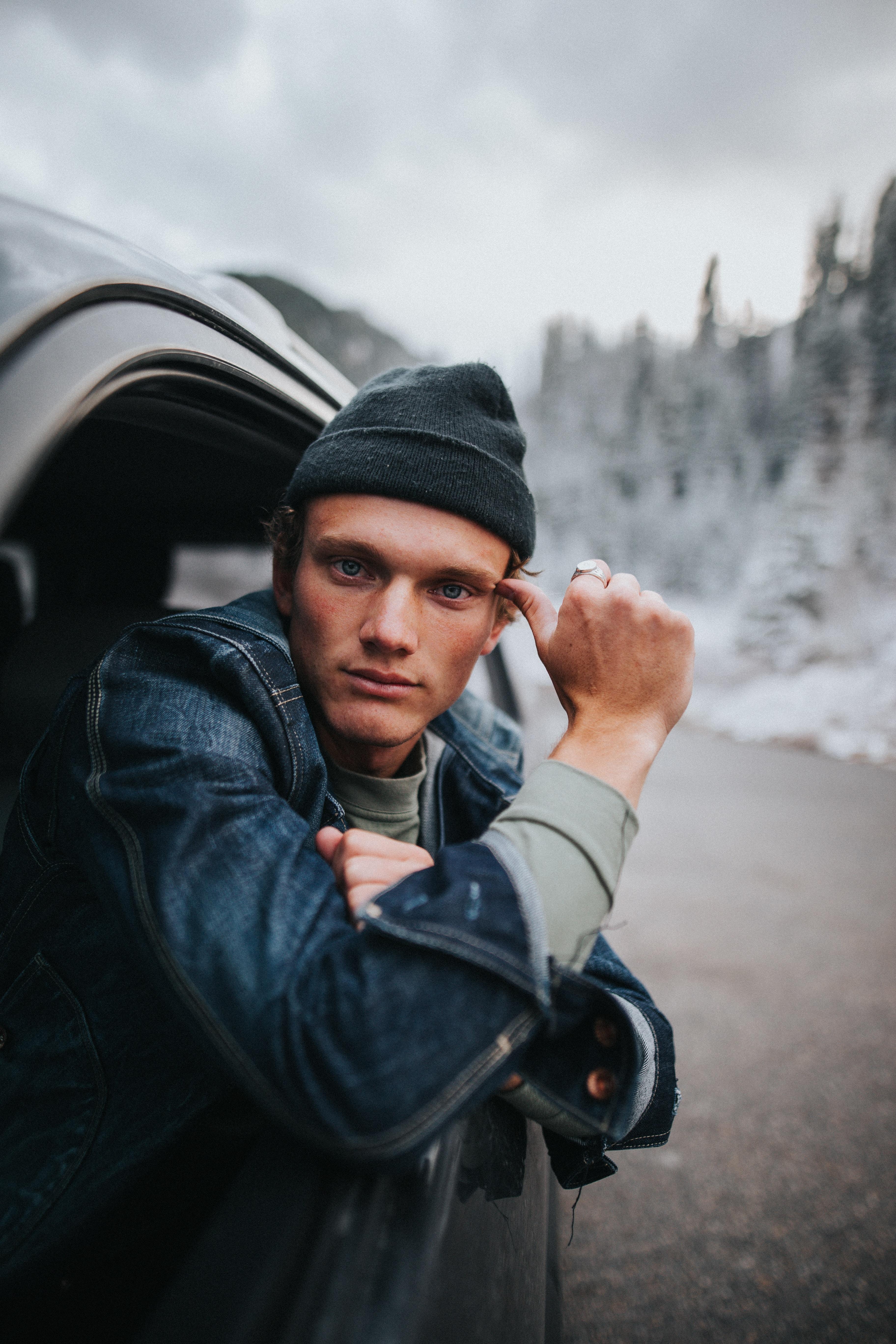 man sitting inside black vehicle