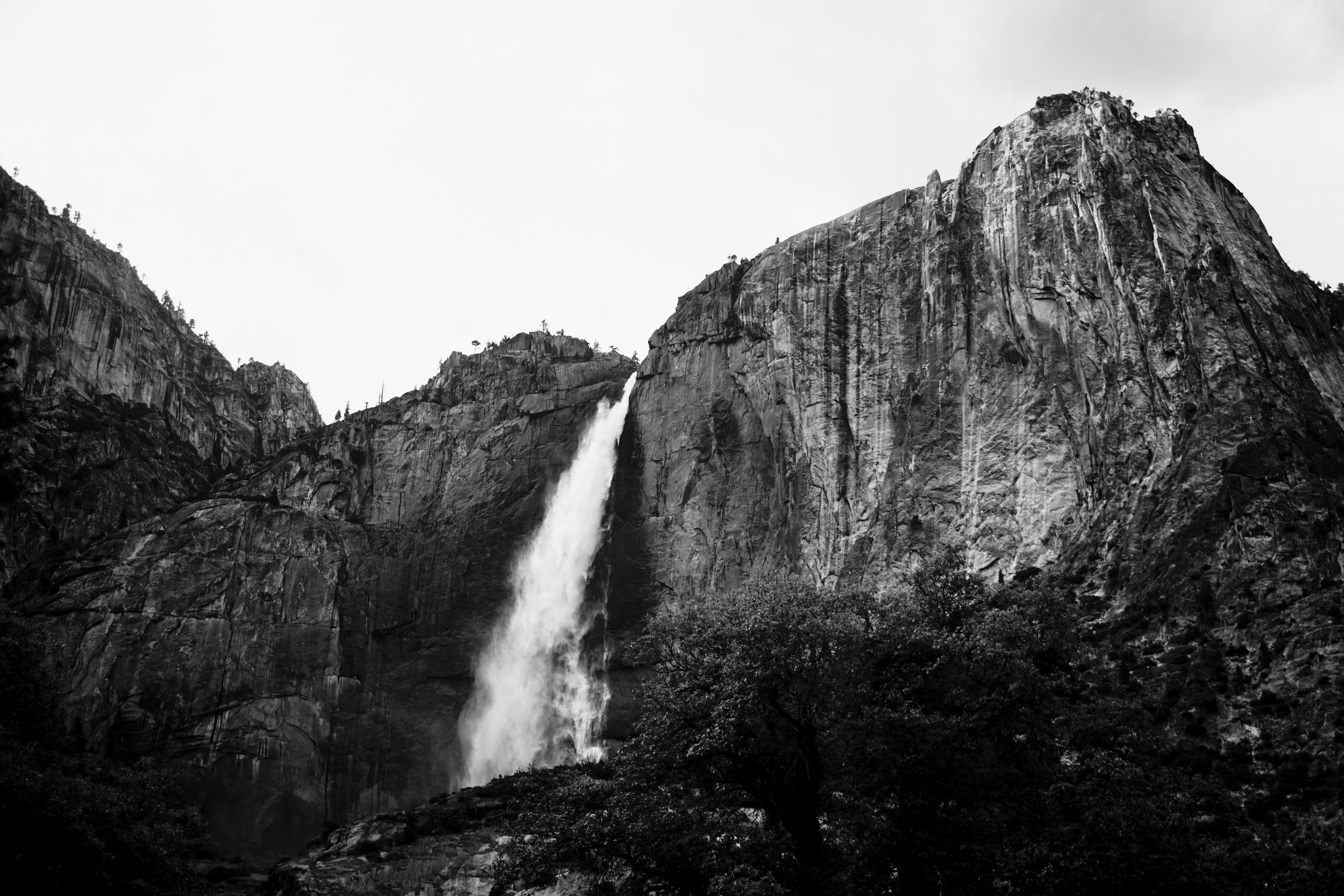 grayscale photography of plunge waterfall at daytime