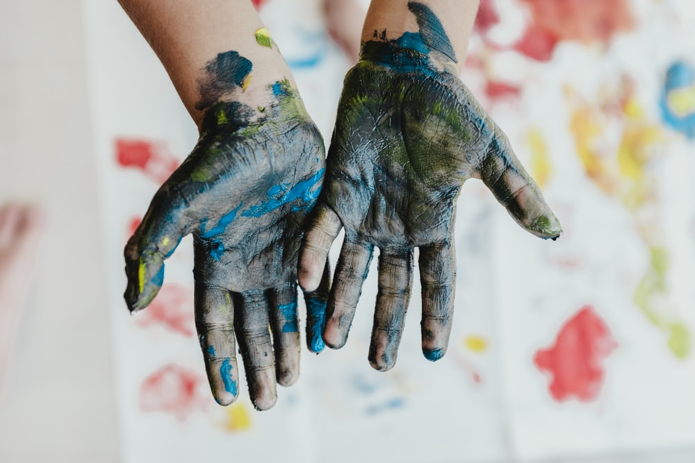person hands with green paint