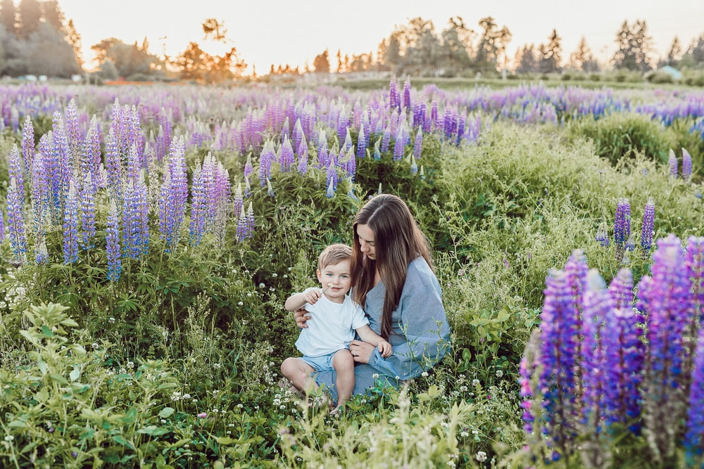 woman sitting surrounded by grape hyacinth