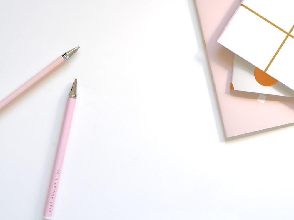 two pen near book