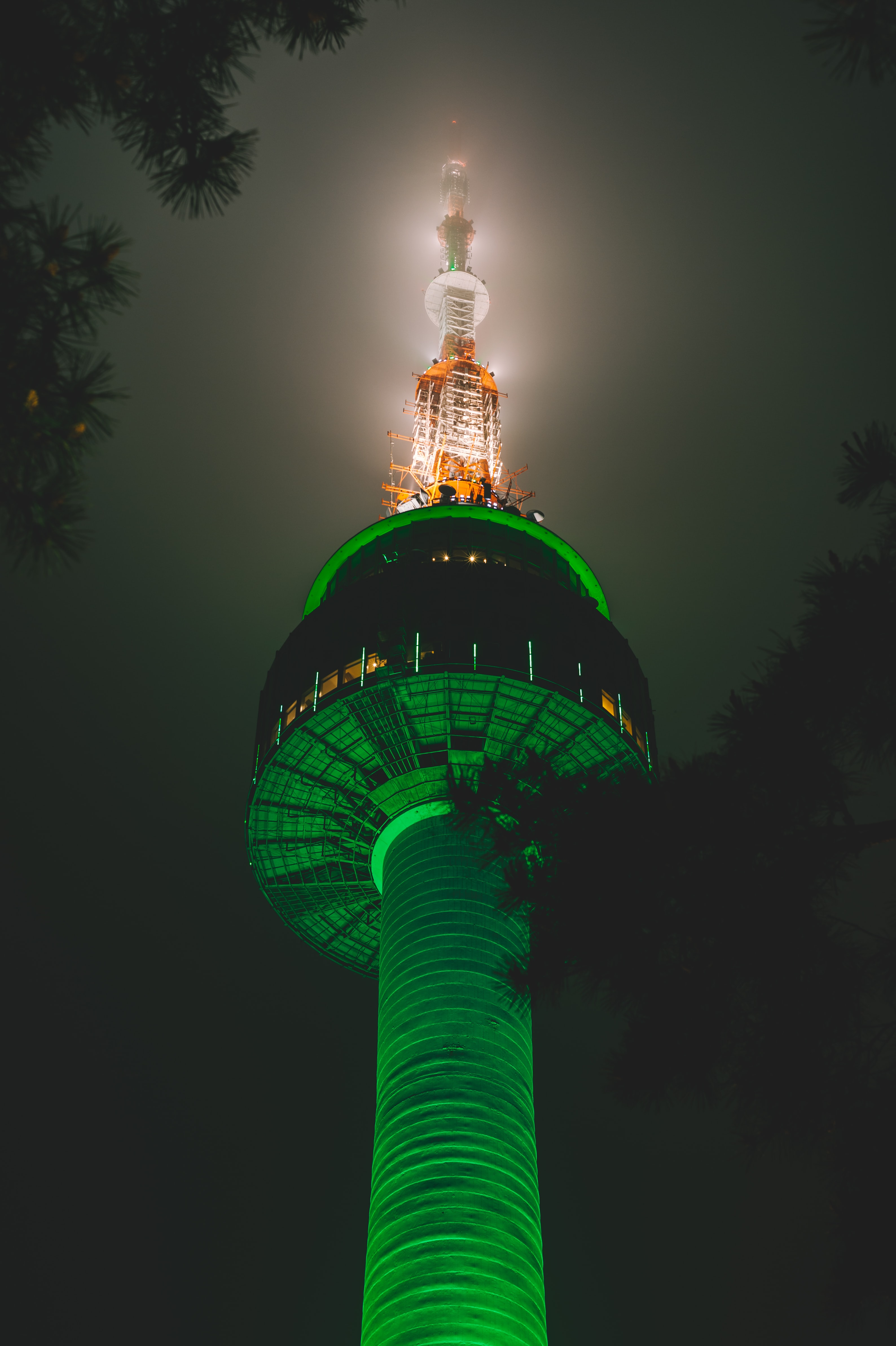 turned on green and white lighted tower during nighttime