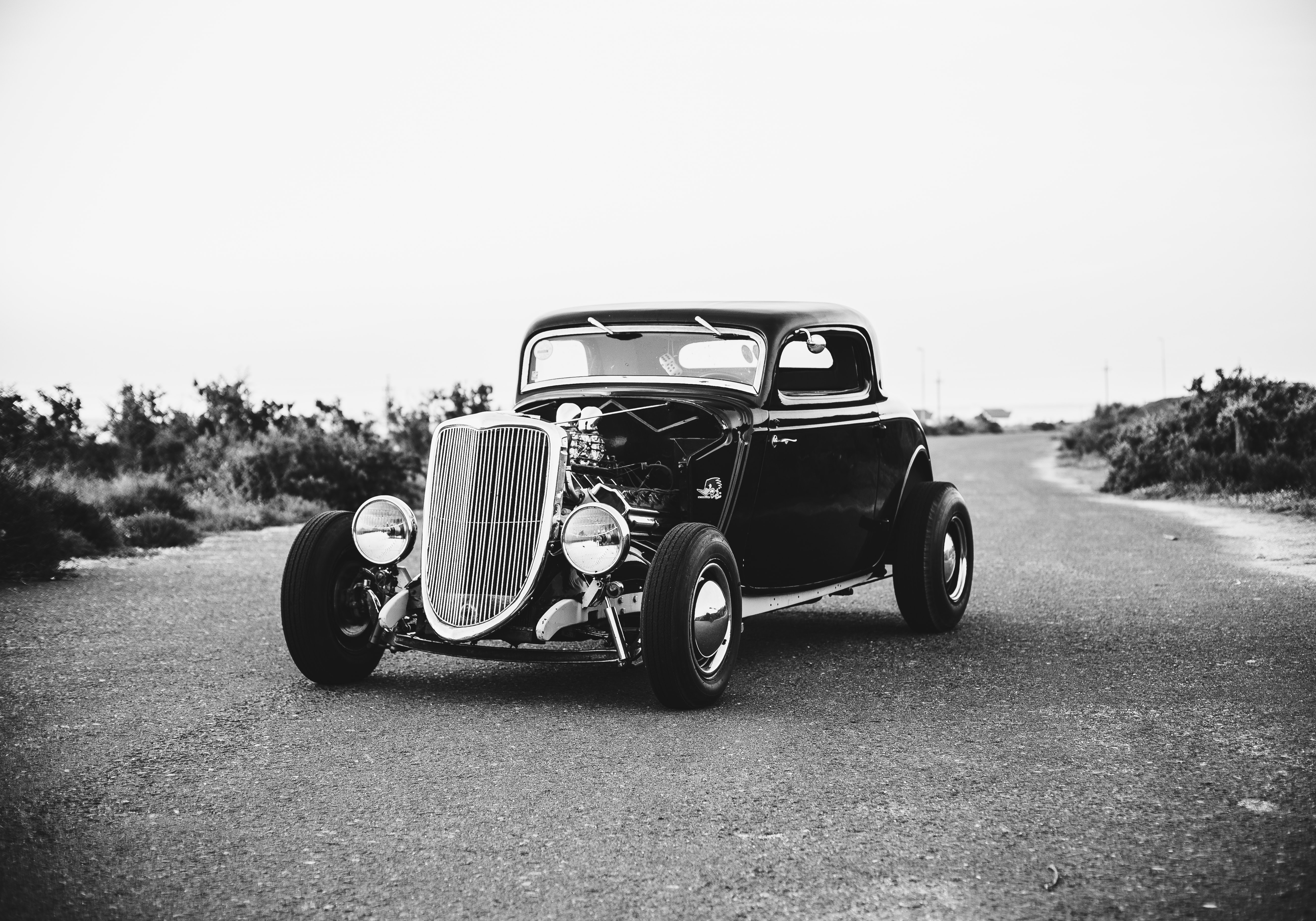 grayscale photography of vintage classic car