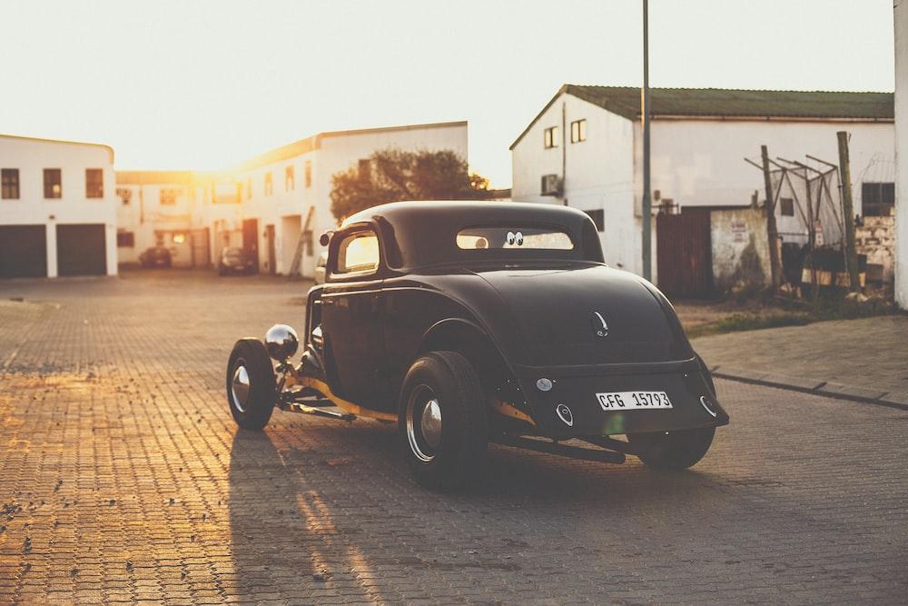 vintage black car on road during daytime