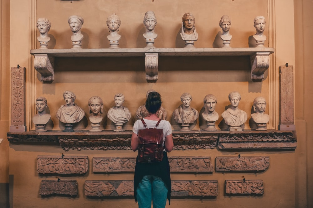 woman watching statues