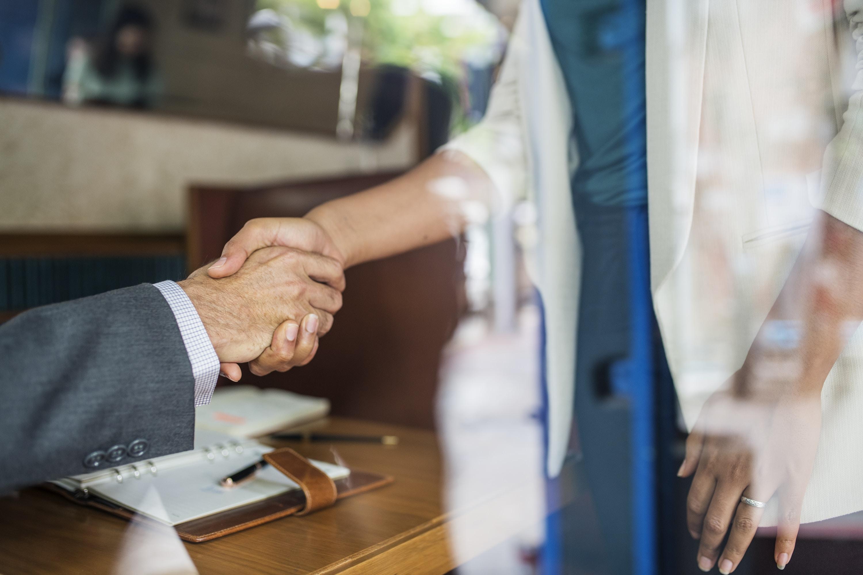woman and man handshaking