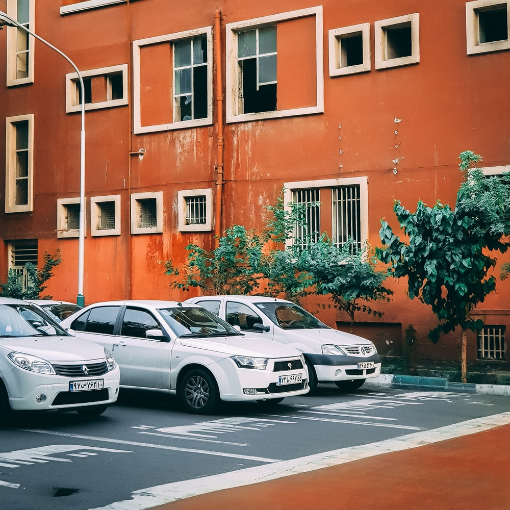 three cars on asphalt roas