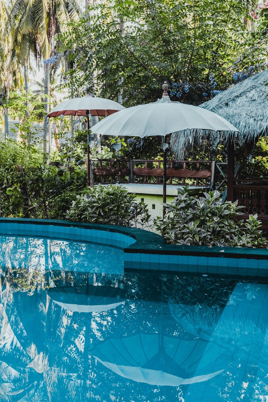 calm pool water near patio umbrella