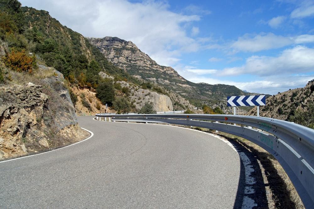 gray road under sunny sky