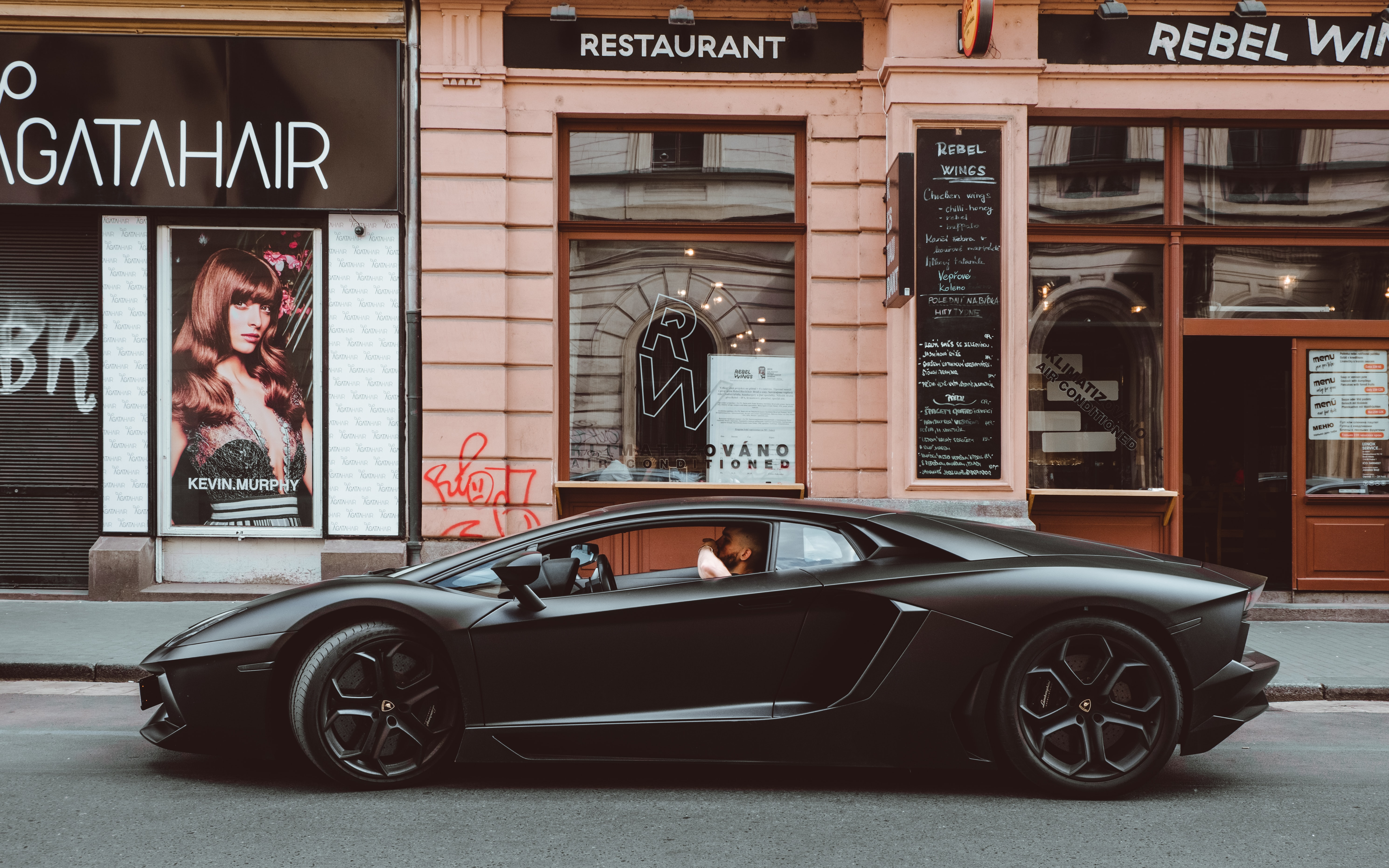 black Lamborghini on the street