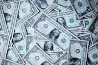 """A collection of US Dollar bills make an interesting financial wallpaper."""