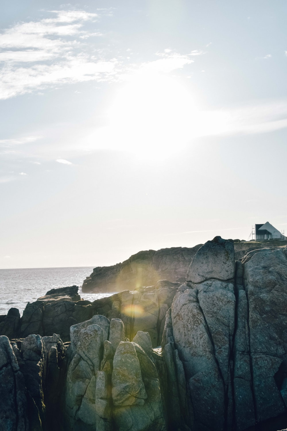 landscape photography of rock formation near beach