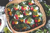 bouquets of flowers in brown wicker basket