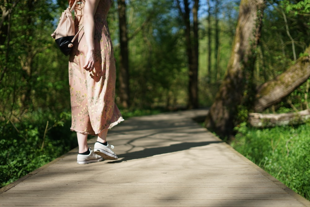woman walking on forest trail
