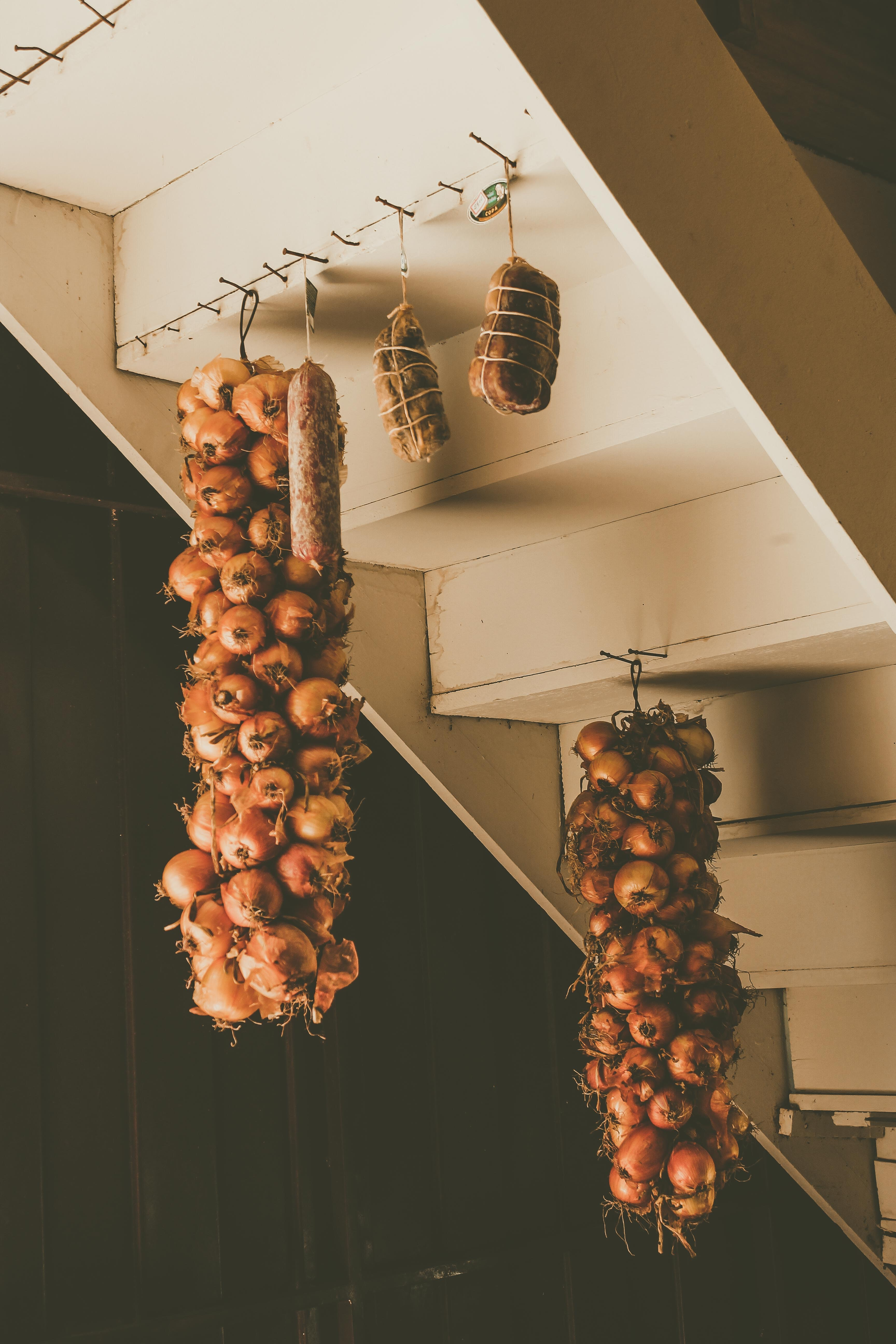 red onions hanging under white stairs