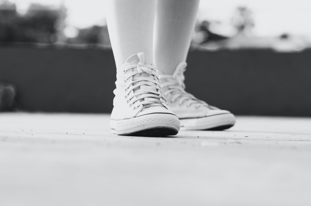 grayscale photography of pair of sneakers