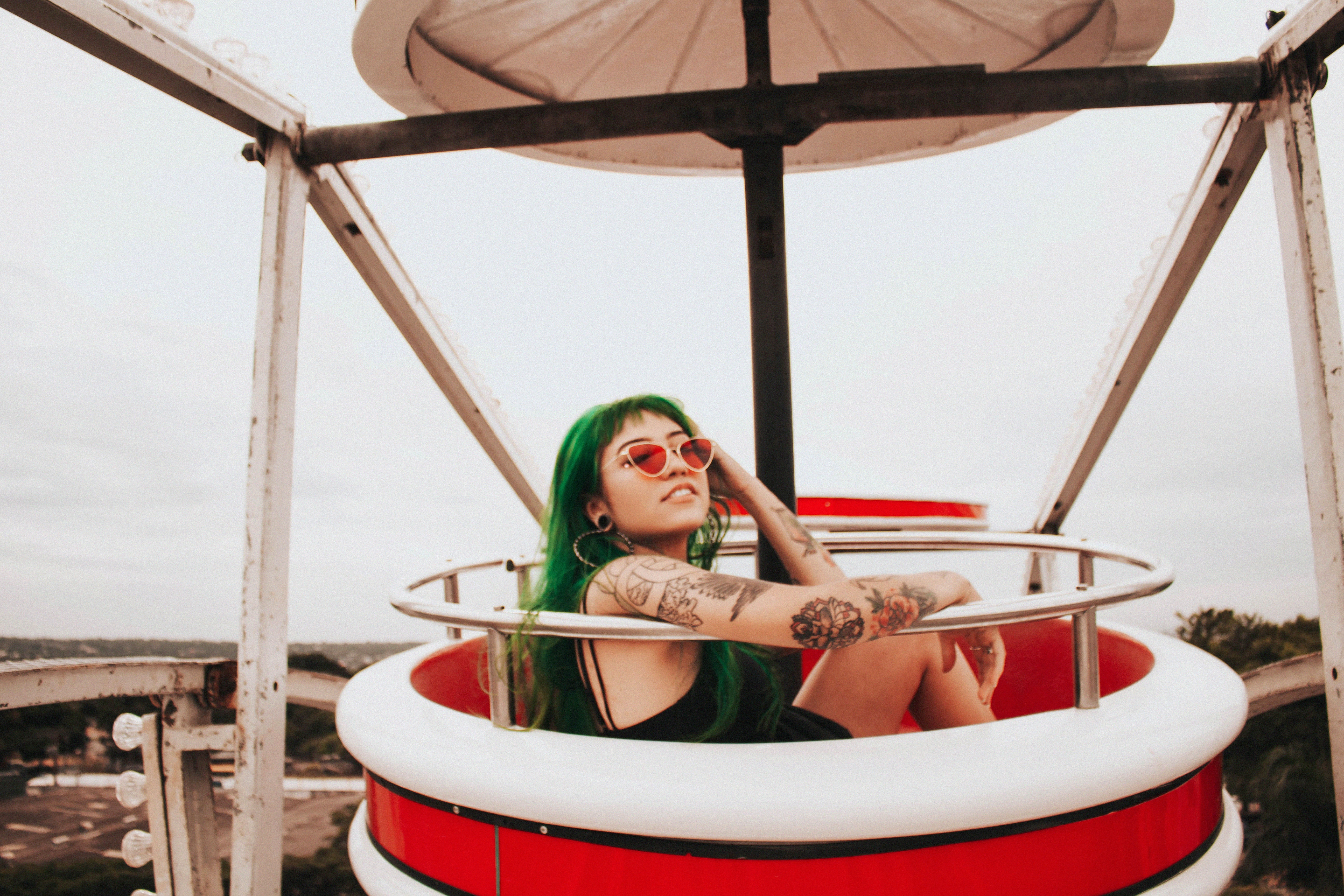 woman sitting on Ferris wheel seat