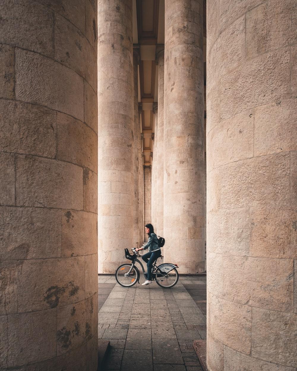 woman biking inside building