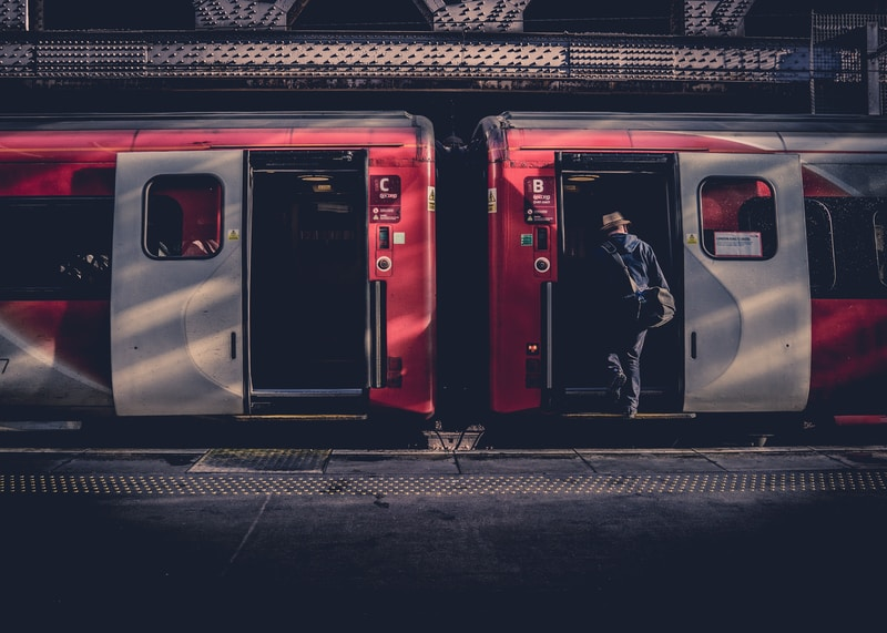man about to go inside the train