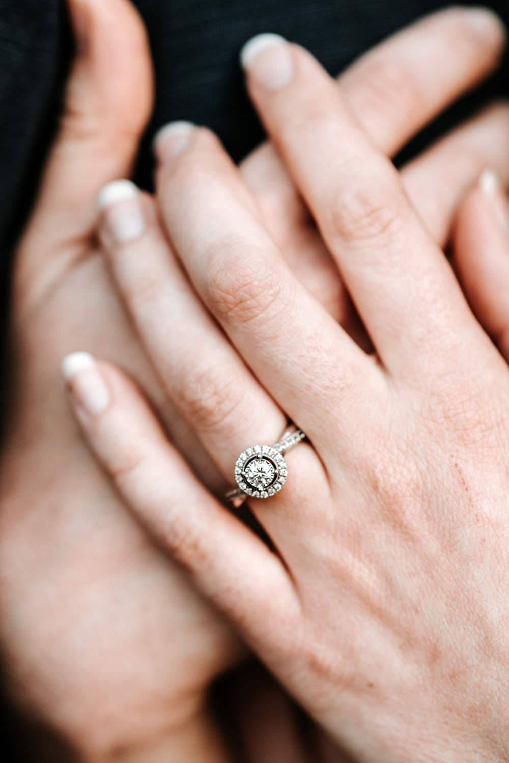 person wearing silver-colored ring