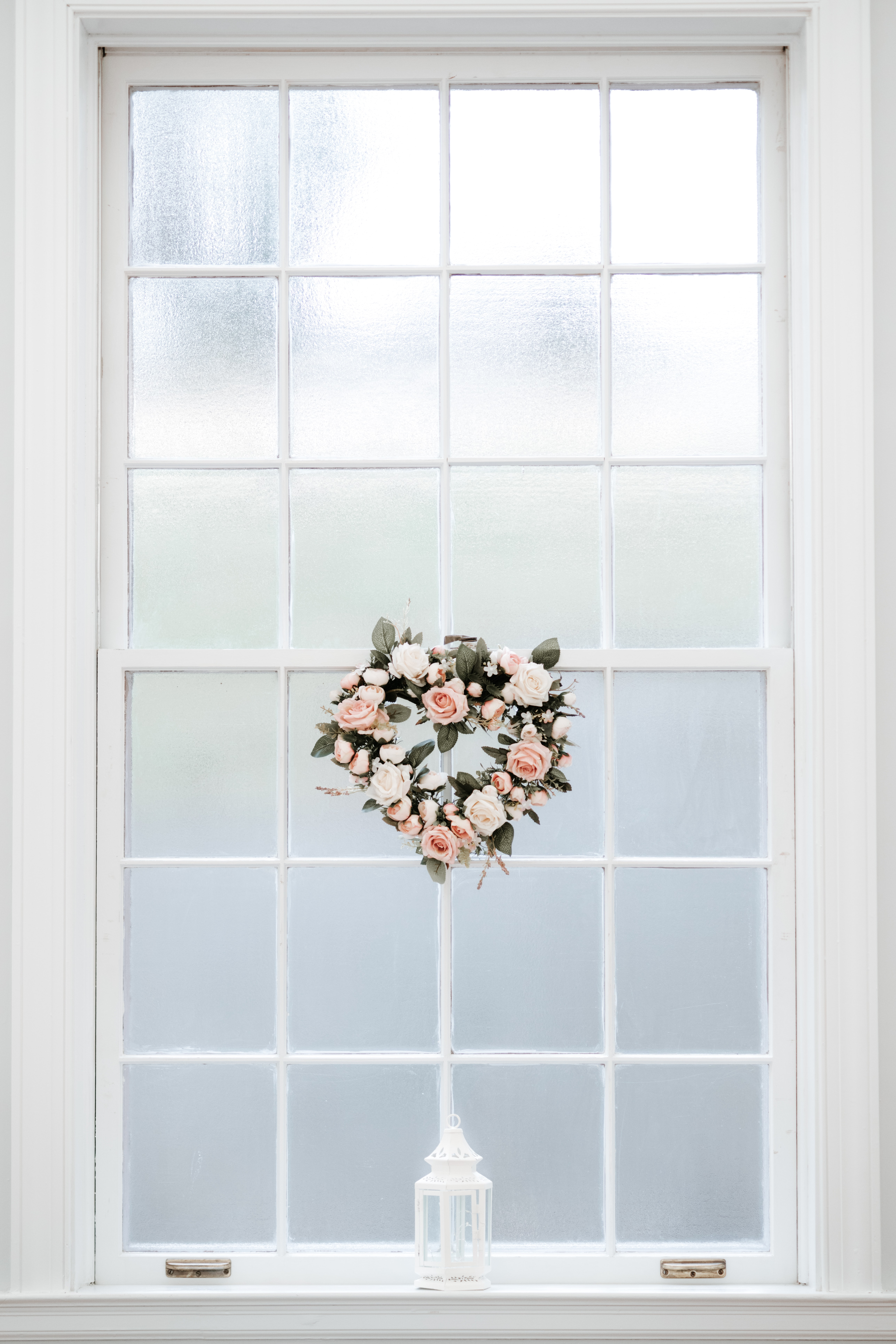 photo of pink and white rose wreath