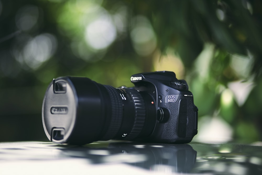 black Canon EOS 50D DSLR camera