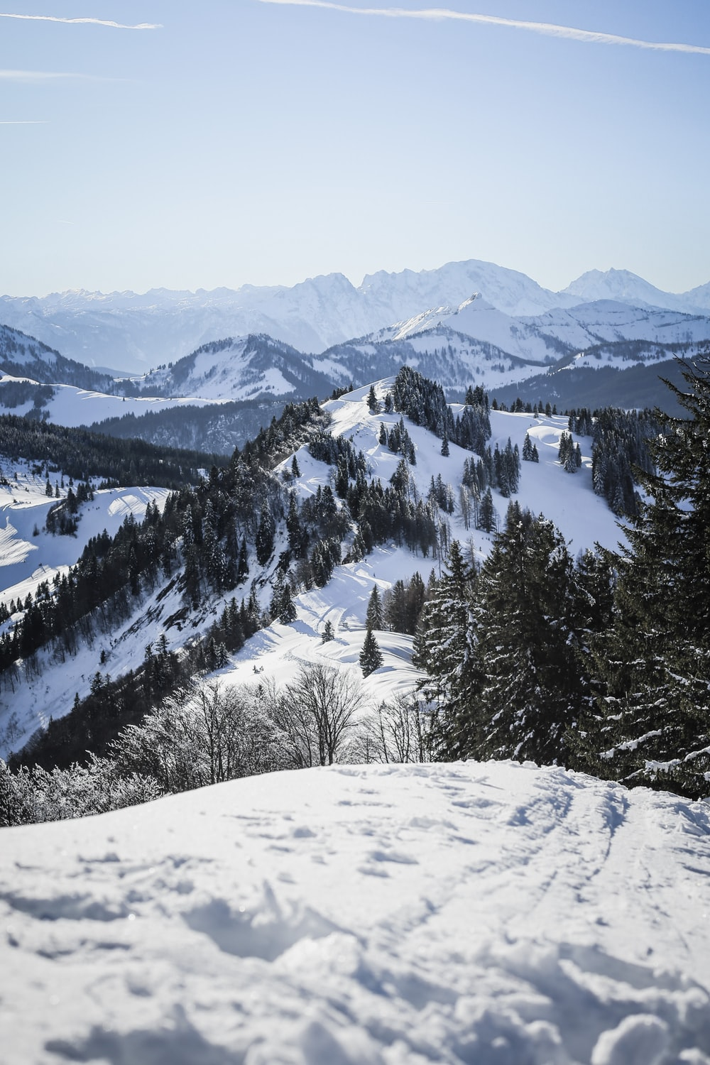 high-angle photography of snow coated mountains