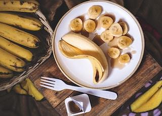 sliced ripe banana on round white ceramic plate