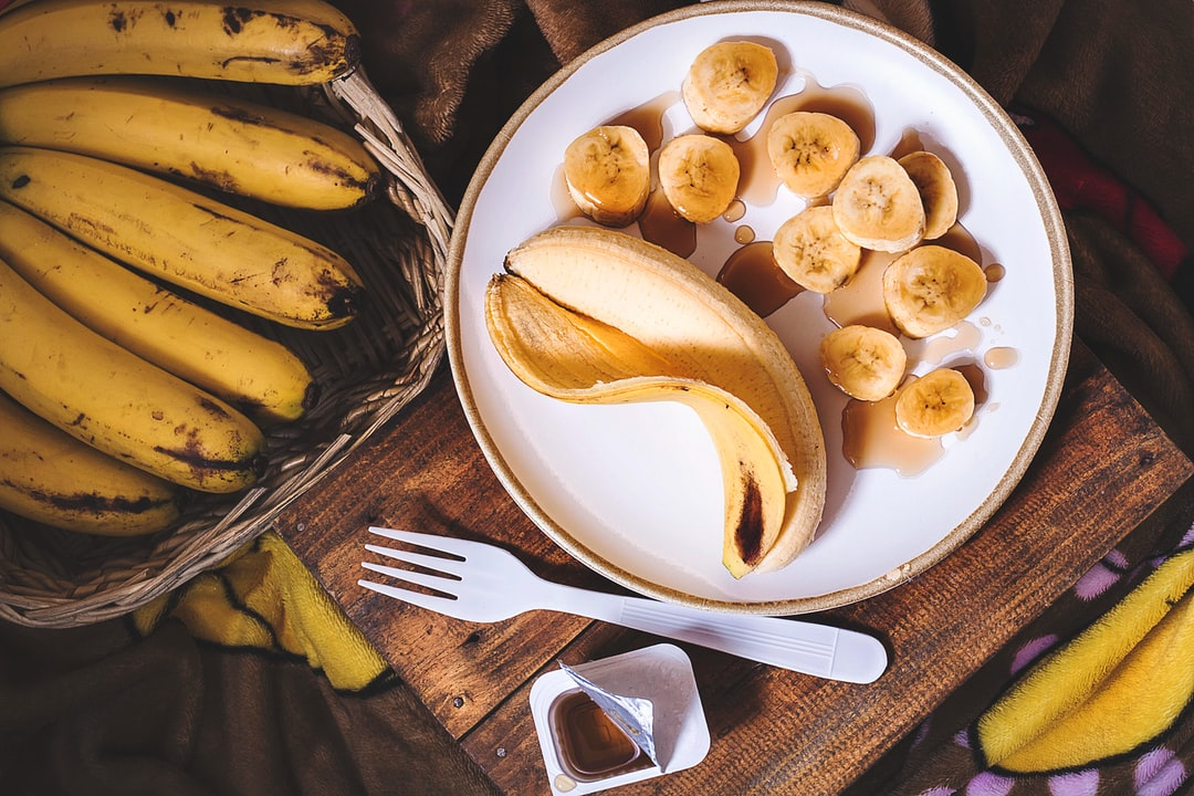 sliced ripe banana on round white ceramic plate