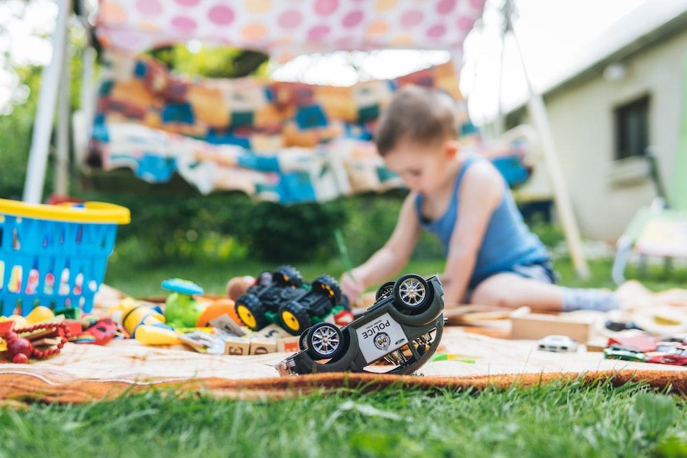 boy playing toy car