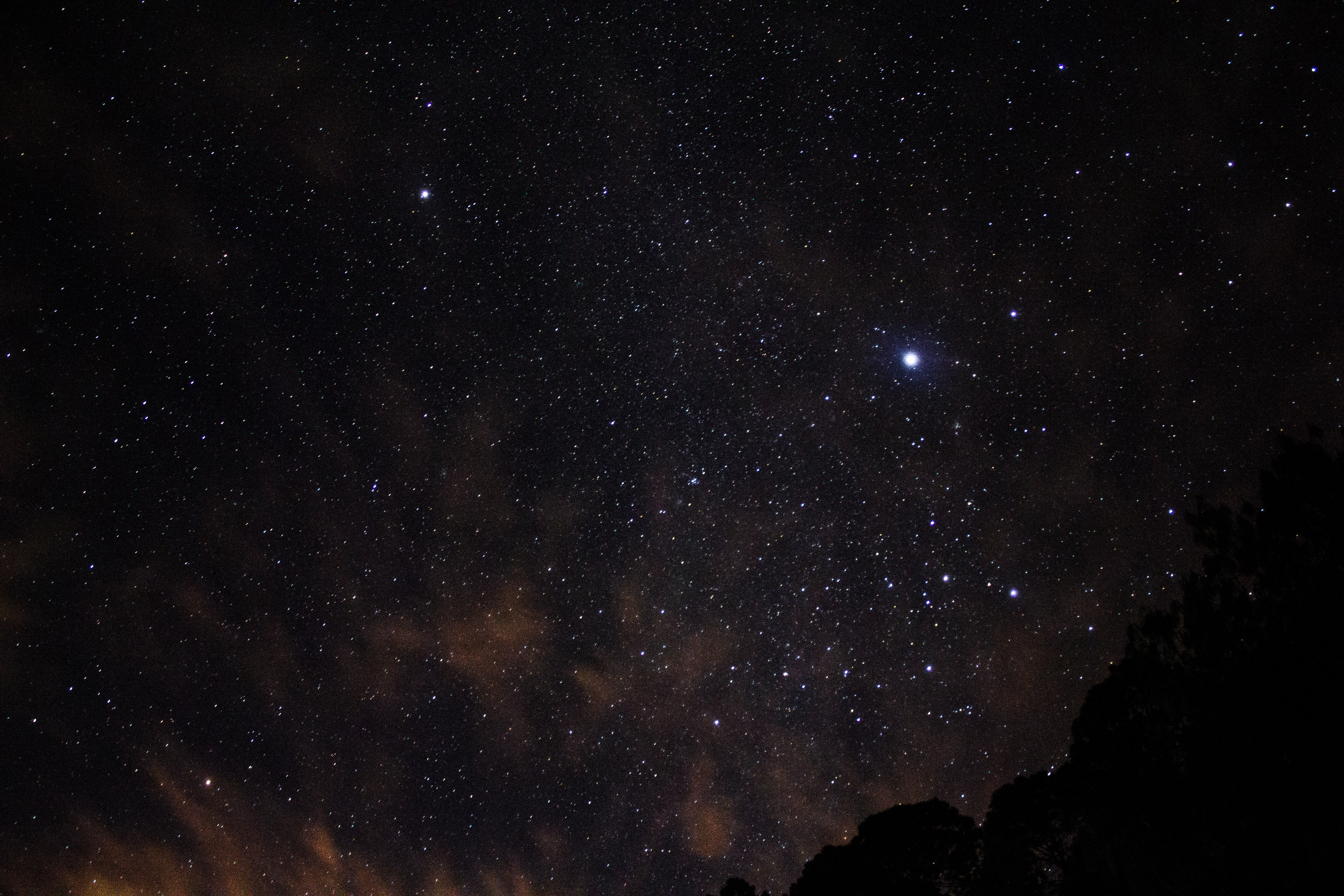 silhouette of mountains and view of stars