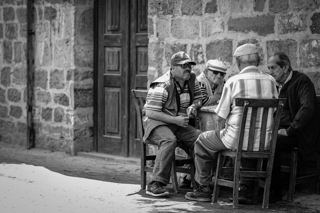 I saw the old men talkin each other then took the picture from far away because i did not want them to notice me. And realise that one them is just like a thug life character.