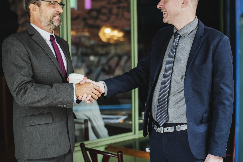 two men doing hand shake