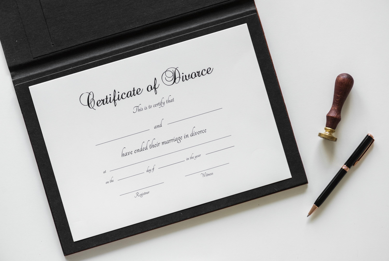Certificate of Divorce printer paper beside twist pen