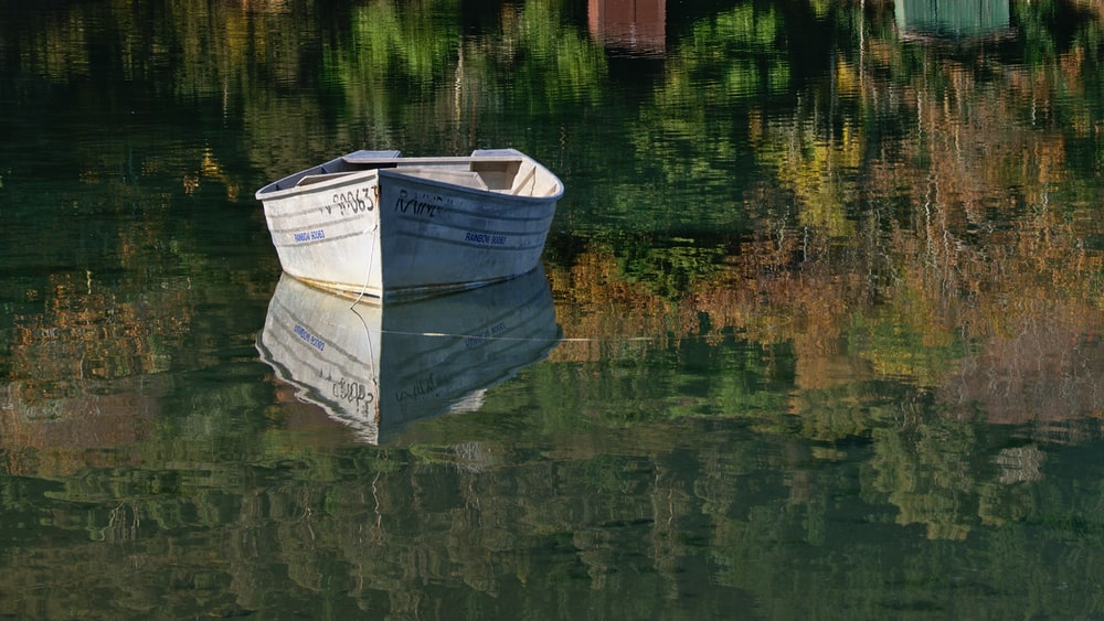 gray boat on river at daytime