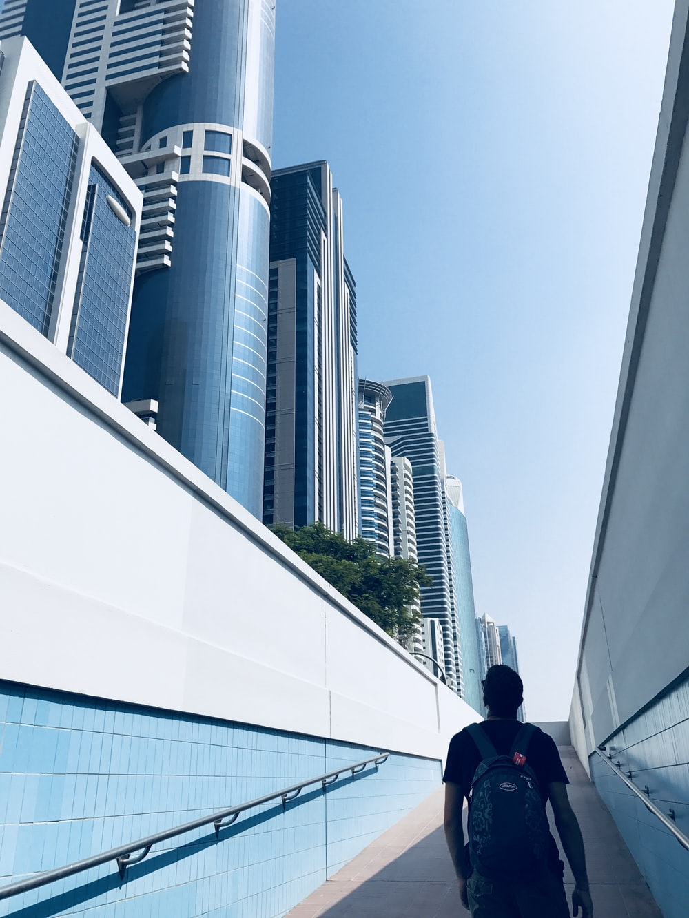 man standing on hallway near buildings during daytime