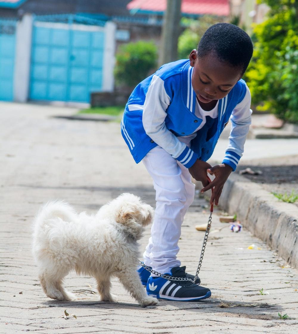 boy taking a walk with dog