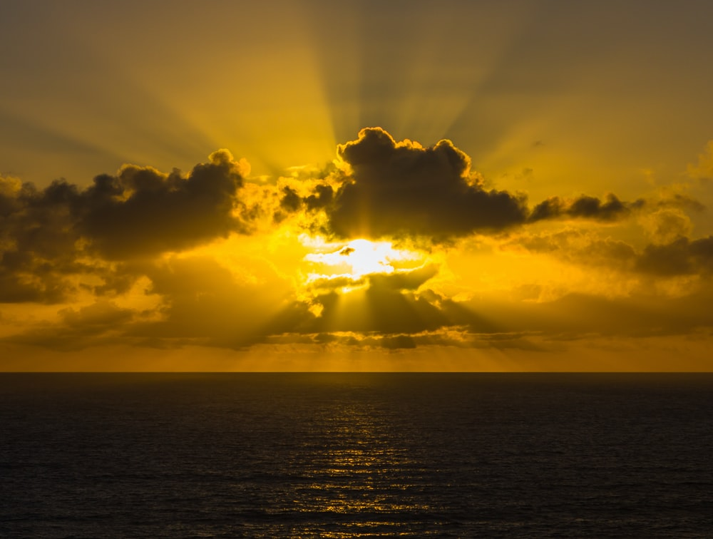 golden hour photography of sky above ocean