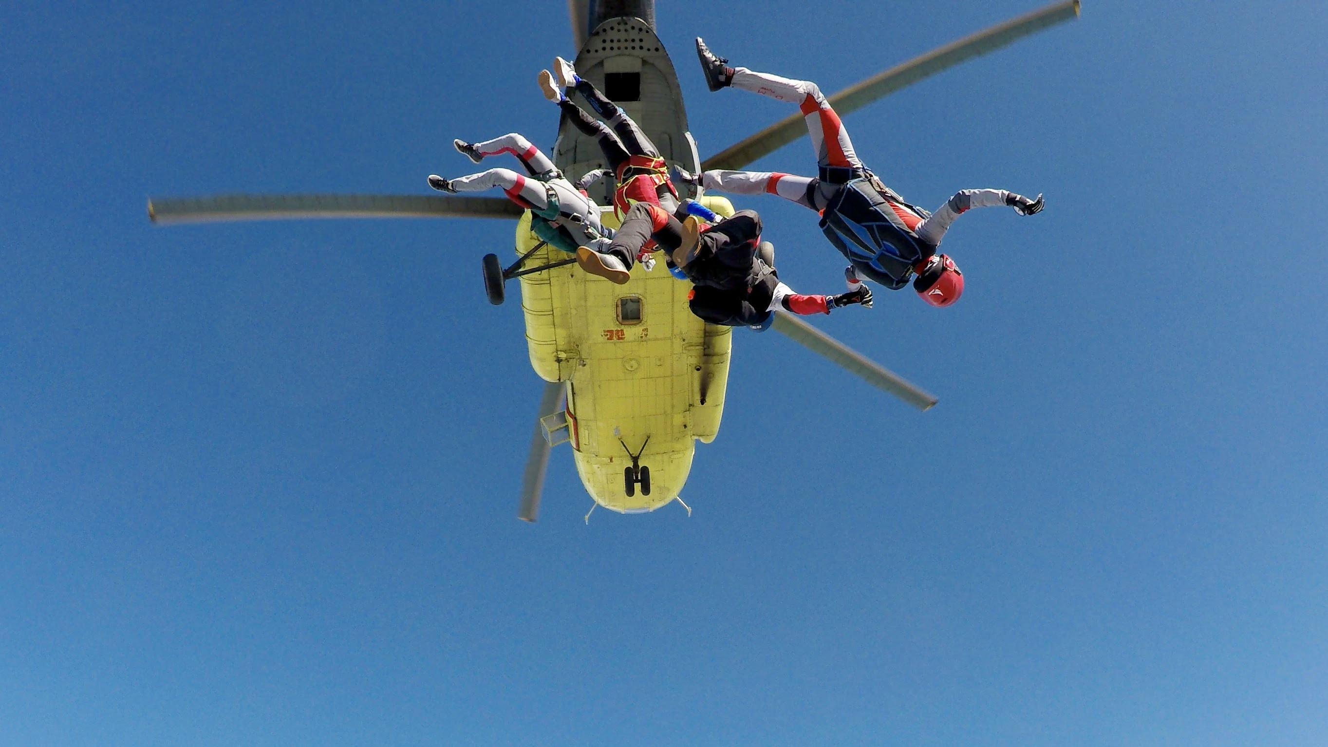 three skydiving people